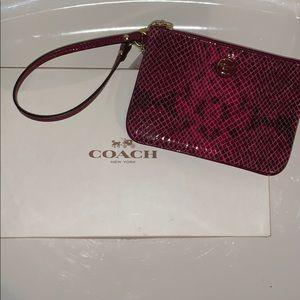 Coach corner zip wristlet pink snakeskin